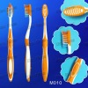 (M010) adult toothbrush with double-action bristle and rubber tongue cleaner